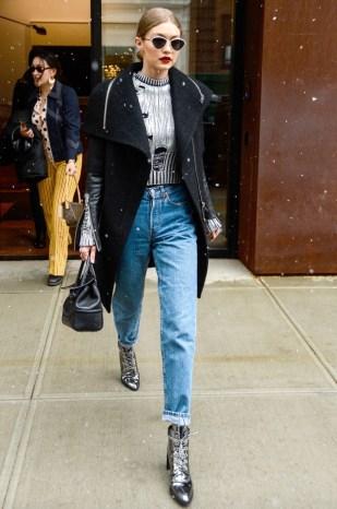 January 31, Black Rudsak coat, Zoe Jordan metallic silver sweater, high-waisted jeans, Gigi x Stuart Weitzman booties, black leather Versace handbag and cat-eyed sunglasses by Le Specs