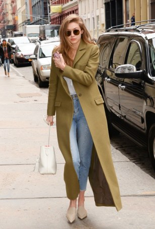 January 27, Floor-length olive green coat, white tee, Sandro high-waisted jeans, pointed-toe Nicholas Kirkwood shoes, white Tom Ford bucket bag and Sunday Somewhere round sunglasses