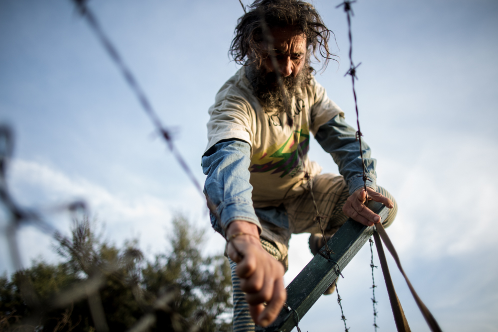 Peace in Nature. Niscemi, Sicily.                                       11/11/2015 . Turi bypasses the US military fence. He will remain climbed over the MOUS antennas for 48 hours without food or water.                                              ©Andrea Coco