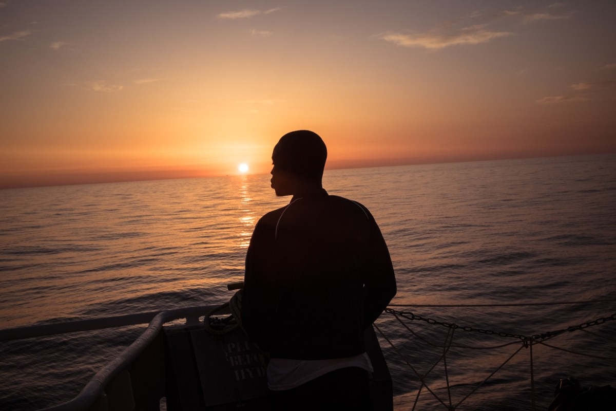 On February 23rd 2017, at sunrise, a young migrant observes the sea from the Aquarius.