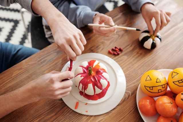 people painting pumpkins