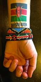 """African commitment tattoo: Kenya Flag & the words maisha moja which means """"One Life""""."""