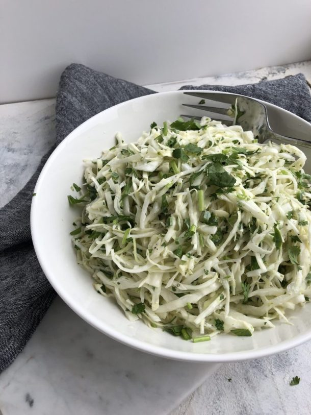 A fresh, crunchy coleslaw bursting with flavor from lime juice, lime zest, cilantro, and an entire minced jalapeño. If you prefer a milder version, deseed the jalapeño or leave it out entirely -- it will still be delicious!
