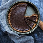 mexican chocolate pie in pie pan, with napkin and cutting board underneath