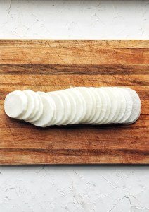 radish medallions on wooden cutting board
