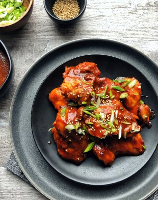 gochujang chicken on a black plate