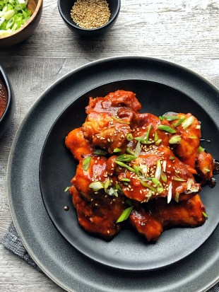 gochujang chicken on black plate