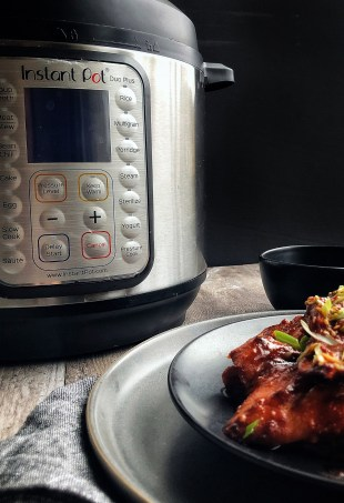 gochujang chicken on a plate and Instant Pot