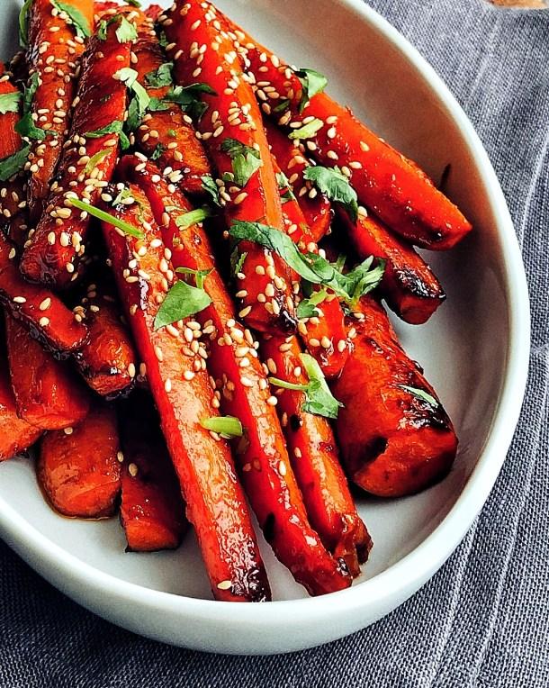close up of Gochujang Roasted Carrots on a platter