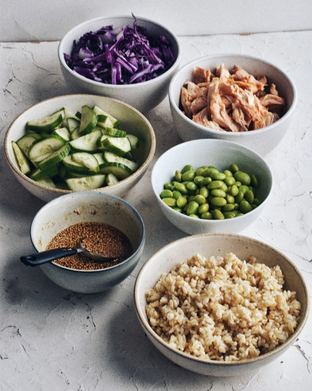 asian rice bowl ingredients, separated into smaller bowls