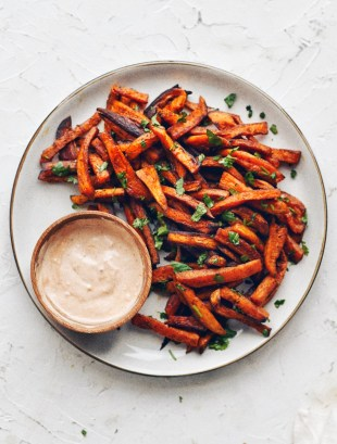 plate of sweet potato fries with aioli in small bowl