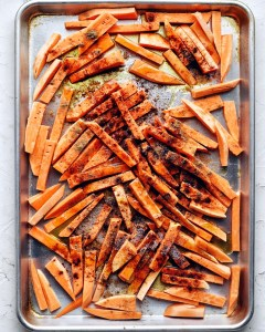 sweet potatoes with spices on sheet pan