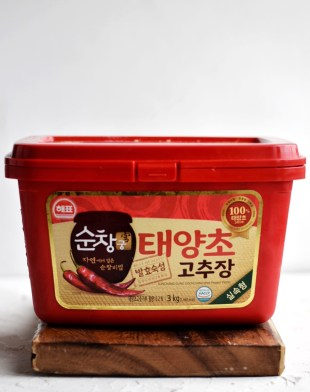 tub of Gochujang on cutting board