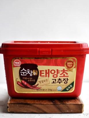 tub of Gochujang on cutting board