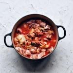 kimchi stew (kimchi jjigae) uncooked in big pot