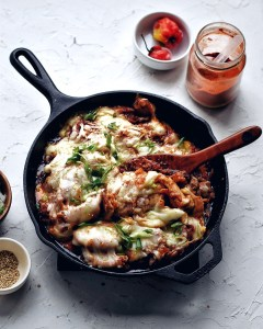 cheese buldak in cast iron skillet with wooden spoon