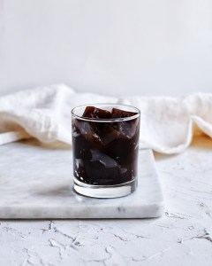 coffee jello in glass on top of marble board