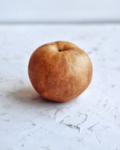asian pear on white table