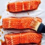 brushing glaze on salmon fillets