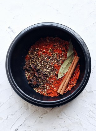 black ceramic bowl with dry ingredients for chinese chili oil