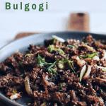 Korean beef bulgogi on a platter and cutting board