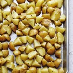sheet pan of quartered potatoes