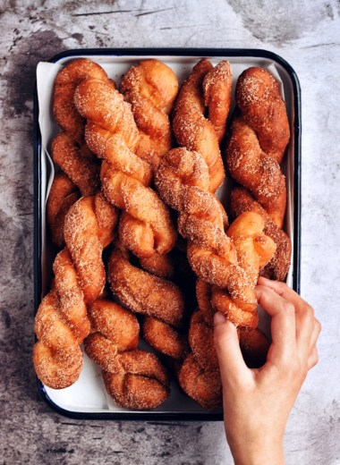 tray of korean donut twists with hand grabbing one