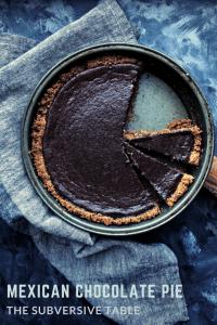 mexican chocolate pie in dark pie tin with grey naptkin and dark background