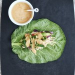 collard green layered with vegetables and peanut sauce