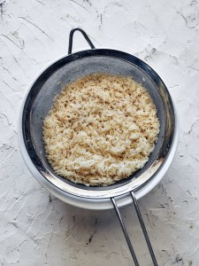 sieve filled with basmati rice