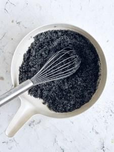 bowls with sugar, black sesame powder, and coconut milk