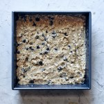 square baking pan with unbaked oatmeal bar