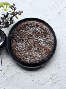 Chocolate Espresso Almond Cake on grey plate