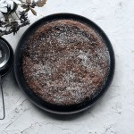 Chocolate Espresso Almond Cake on grey plate
