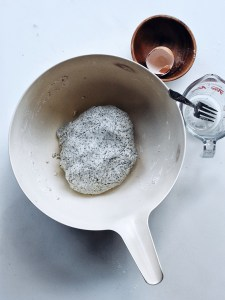 black sesame mochi donut dough in white bowl
