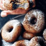 hand holding black sesame mochi donut