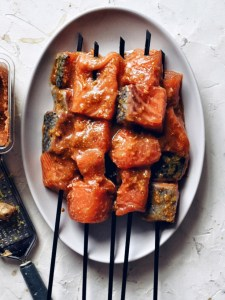 salmon skewers on oval plate