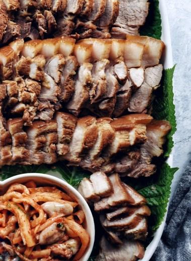 korean boiled pork (bossam) on platter, close up