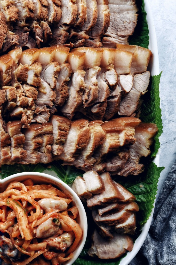korean boiled pork (bossam) on platter, close up