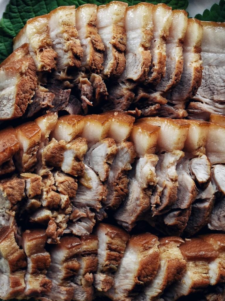 rows of korean boiled pork (bossam)