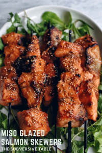 miso salmon skewers on bed of argula