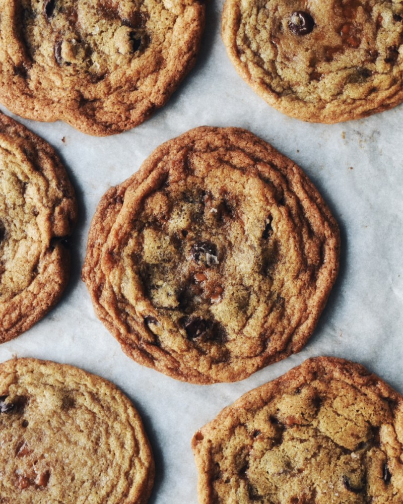 brown butter chocolate chip and toffee cookie on parchment paper