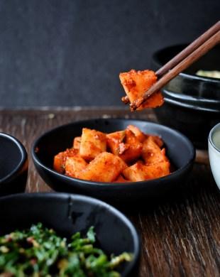chopsticks picking up kkakdugi from bowl