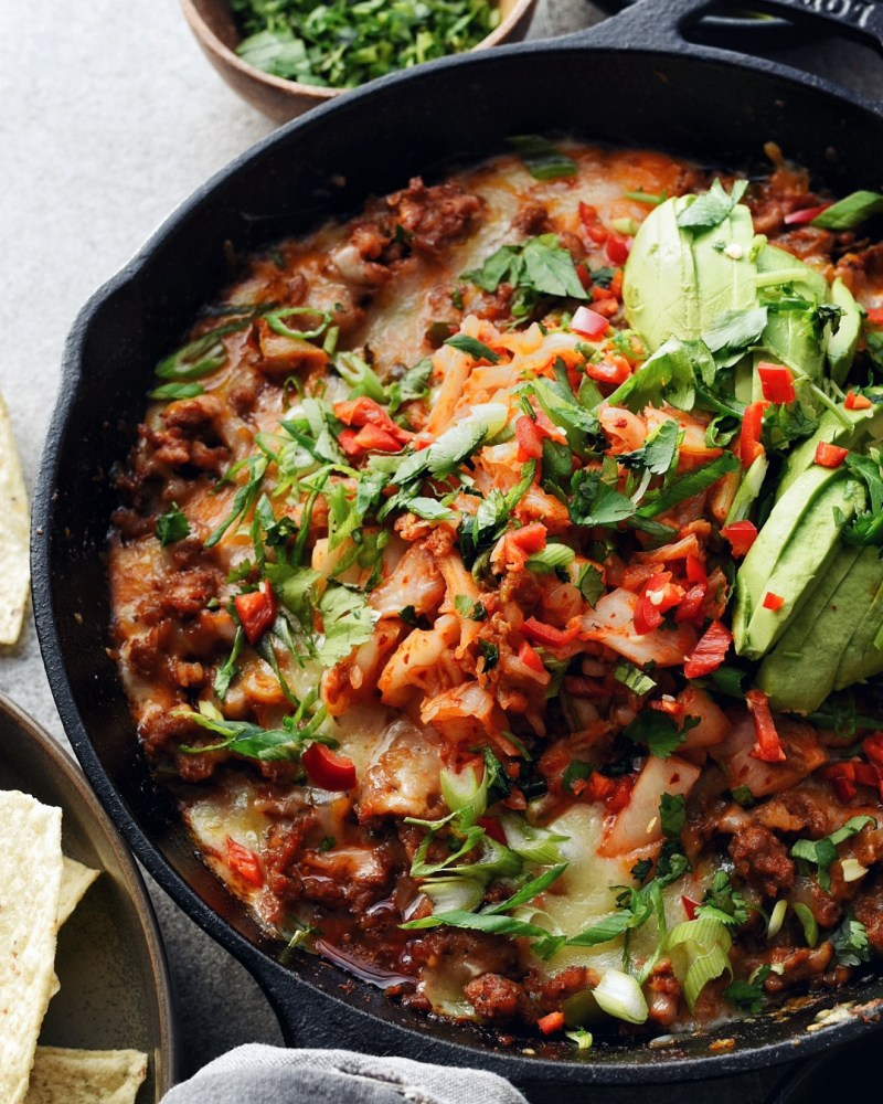 kimchi queso dip in cast iron pan