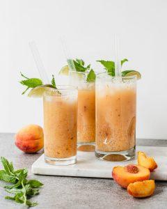 3 peach yakult sago drinks on a cutting board
