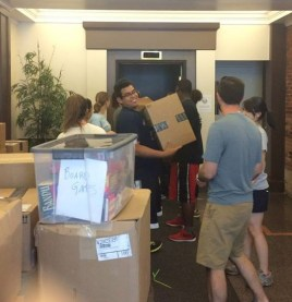 Moving Day! Staff are busy packing up books, binders, computers, microscopes and everything else needed for six weeks of rigorous summer learning.