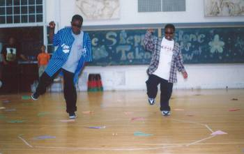 Chuks and Emeka show off their moves during the Steppingstone talent show