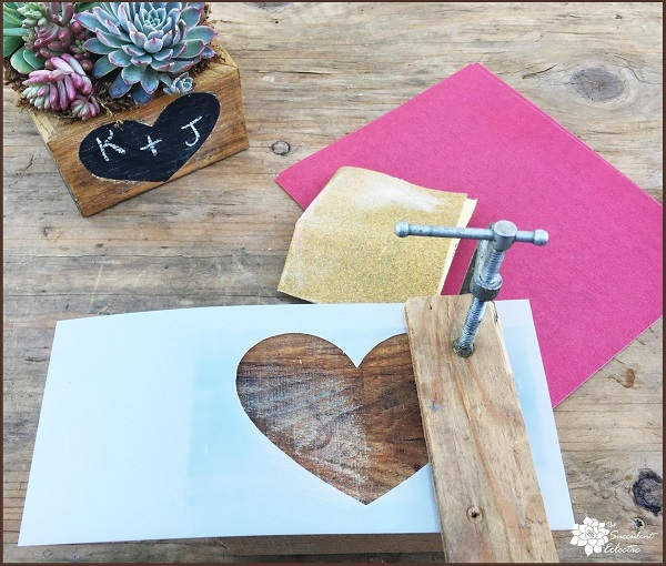 Valentine's Day DIY sanding heart into reclaimed wood