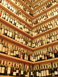 2 walls filled with wine bottles on shelves