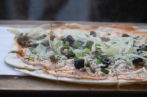 Vegetarian Flamkuchen with olives and cheese